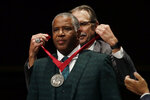 Billionaire businessman Robert F. Smith receives the W.E.B. Dubois Medal during ceremonies at Harvard University for contributions to black history and culture, Tuesday, Oct. 22, 2019, in Cambridge, Mass. (AP Photo/Elise Amendola)