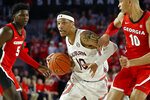Auburn guard Samir Doughty (10) moves the ball past Georgia's Toumani Camara (10) and Anthony Edwards (5) during an NCAA college basketball game Wednesday, Feb. 19, 2020, in Athens, Ga. (Joshua L. Jones/Athens Banner-Herald via AP)