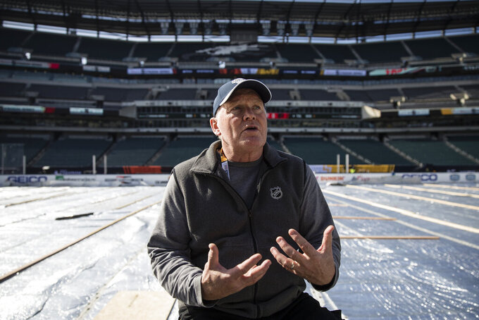 NHL vice president of facilities operations and hockey operations Dan Craig speaks during an interview with The Associated Press ahead of the NHL Winter Classic hockey game between the Pittsburgh Penguins and Philadelphia Flyers, in Philadelphia, Thursday, Feb. 21, 2019. (AP Photo/Matt Rourke)