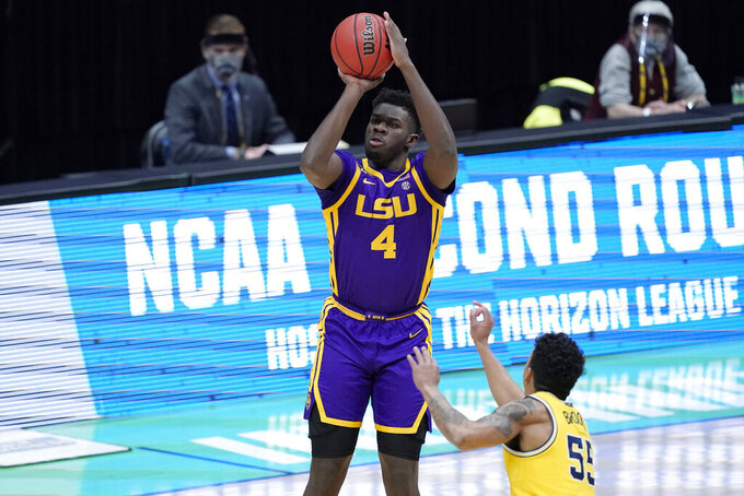 FILE - LSU forward Darius Days (4) shoots over Michigan guard Eli Brooks (55) during the first half of a second-round game in the NCAA men's college basketball tournament at Lucas Oil Stadium in Indianapolis, in this Monday, March 22, 2021, file photo. Forward Darius Days is returning to LSU for his senior season after initially exploring his opportunity to turn pro. Days, who announced his decision during an online talk show appearance in Baton Rouge on Tuesday, June 29, 2021, had previously declared his intention to enter this summer's NBA draft after last season.(AP Photo/AJ Mast, File)