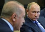Russian President Vladimir Putin, right, listens to Turkish President Recep Tayyip Erdogan during their meeting in the Bocharov Ruchei residence in the Black Sea resort of Sochi, Russia, Tuesday, Oct. 22, 2019. Welcoming the Turkish leader in Russia's Black Sea resort of Sochi on Tuesday, Putin said their meeting is very important in the current tense situation in Syria. (Alexei Druzhinin/Sputnik, Kremlin Pool Photo via AP)