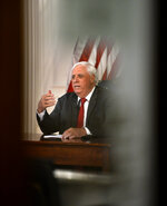 West Virginia governor Jim Justice Monday, March, 23, 2020, issued a stay at home order, effective 8 p.m. Tuesday from his office in the WV State Capitol in Charleston, W. Va. Orders all non-essential businesses closed. (Kenny Kemp/Charleston Gazette-Mail via AP)