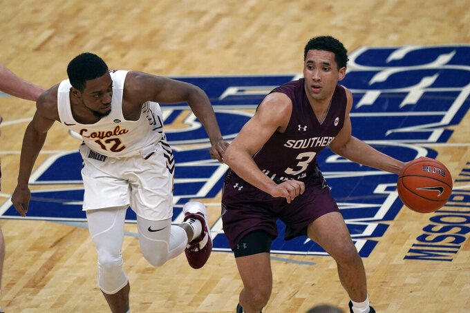 Southern Illinois' Dalton Banks (3) brings the ball down the court as Loyola of Chicago's Marquise Kennedy (12) defends during the first half of an NCAA college basketball game in the quarterfinal round of the Missouri Valley Conference men's tournament Friday, March 5, 2021, in St. Louis. (AP Photo/Jeff Roberson)