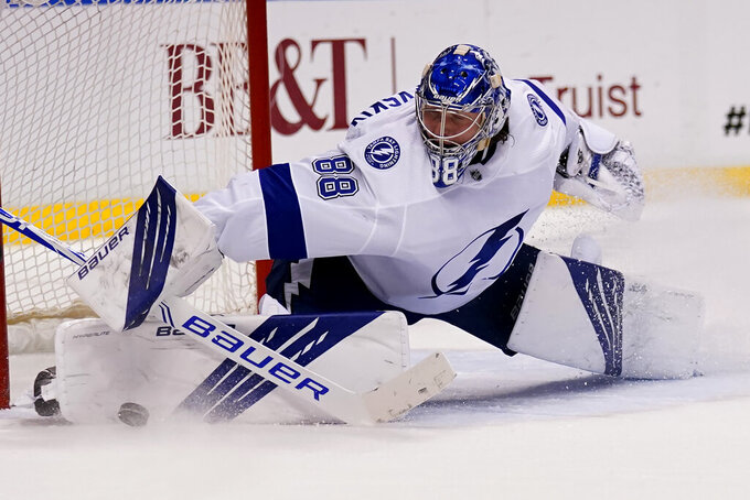 Tampa Bay Lightning goaltender Andrei Vasilevskiy (88) stops the puck during the second period in Game 5 of an NHL hockey Stanley Cup first-round playoff series against the Florida Panthers, Monday, May 24, 2021, in Sunrise, Fla. (AP Photo/Lynne Sladky)