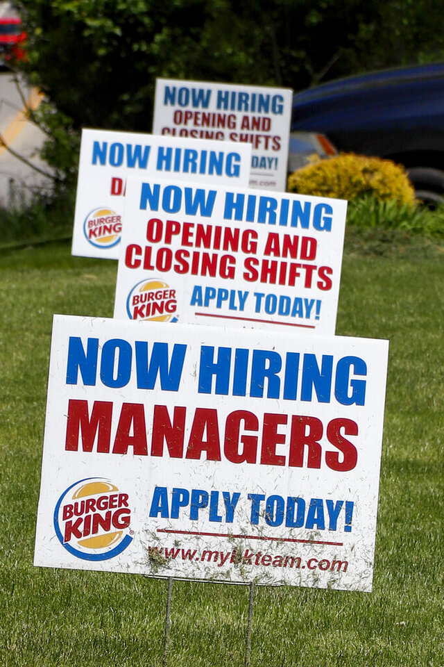 A row of signs advertising jobs are posted in front of a Burger King restaurant, Thursday, May 21, 2020, in Harmony, Pa. The number of Americans applying for unemployment benefits in the two months since the coronavirus took hold in the U.S. has swelled to nearly 39 million, the government reported Thursday, even as states from coast to coast gradually reopen their economies and let people go back to work. (AP Photo/Keith Srakocic)