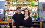 Jake Cerese and Kate Claeys pose for a photo at their restaurant and bar, Kerouac's, Wednesday, June 23, 2021 in rural Baker, Nev. The couple gave up urban life in New York City back in 2017 to move to to the remote area near Great Basin National Park. (Ed Komenda/The Reno Gazette-Journal via AP)