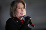 FILE - Attorney Sidney Powell, a member of President Donald Trump's legal team, speaks during a rally on Wednesday, Dec. 2, 2020, in Alpharetta, Ga. Florida's Democratic agriculture commissioner, whose office polices charities, alleged Friday, June 18, 2021, that a group run by Powell, one of former President Donald Trump's most prominent election conspiracy adherents, is illegally seeking donations in the state.  Agriculture Commissioner Nikki Fried said her office has filed an administrative complaint against Powell's Defending the Republic group demanding that it obey state law or cease Florida operations.  (AP Photo/Ben Margot, File)