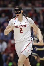 Stanford's Shannon Coffee smiles after a teammate scored during a first-round game against UC Davis in the NCAA women's college basketball tournament in Stanford, Calif., Saturday, March 23, 2019. On Monday night, Coffee will sign the national anthem before Stanford's scheduled second-round game at Maples Pavilion. (AP Photo/Jeff Chiu)
