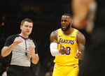 Los Angeles Lakers forward LeBron James (23) argues with an official during the first half of an NBA basketball game against the Atlanta Hawks Tuesday, Feb. 12, 2019, in Atlanta. (AP Photo/John Bazemore)