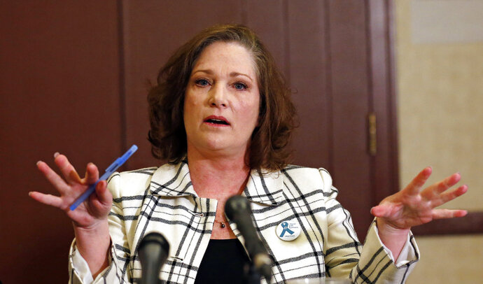 FILE - In this April 5, 2018 file photo McKenna Denson speaks with reporters during a news conference in Salt Lake City. Denson, a woman who says a former Mormon missionary leader raped her in the 1980s is accusing church officials of knowing about the man's prior sexual misconduct before he was appointed. Denson's attorneys allege in a court document filed Tuesday, June 13, 2018, that Joseph L. Bishop disclosed to church leaders his