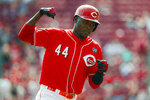 Cincinnati Reds' Aristides Aquino runs the bases after hitting a solo home run off Milwaukee Brewers starting pitcher Chase Anderson in the first inning of a baseball game, Thursday, Sept. 26, 2019, in Cincinnati. (AP Photo/John Minchillo)