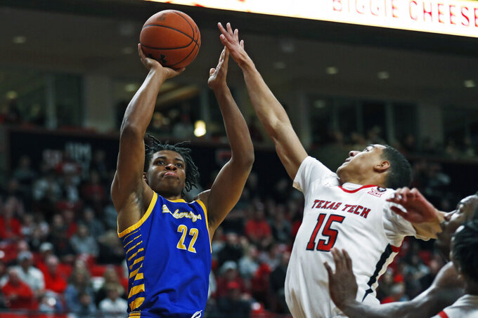 Cal State Bakersfield's Justin McCall (22) shoots the ball over Texas Tech's Kevin McCullar (15) during the first half of an NCAA college basketball game Sunday, Dec. 29, 2019, in Lubbock, Texas. (AP Photo/Brad Tollefson)