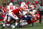 Rutgers linebacker Tyreek Maddox-Williams, left, and defensive lineman Mike Tverdov , right, sack Liberty quarterback Stephen Calvert (12) during the second quarter of an NCAA college football game Saturday, Oct. 26, 2019, in Piscataway, N.J. (Andrew Mills/NJ Advance Media via AP)