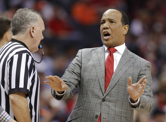 North Carolina State head coach Kevin Keatts, right, argues a call during the first half of an NCAA college basketball game against Virginia in the Atlantic Coast Conference tournament in Charlotte, N.C., Thursday, March 14, 2019. (AP Photo/Chuck Burton)