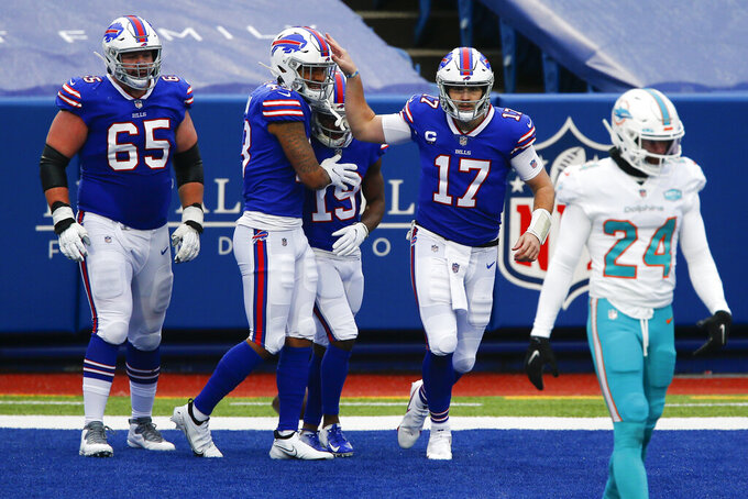 Buffalo Bills quarterback Josh Allen (17) celebrates after wide receiver Isaiah McKenzie (19) caught a touchdown pass in the first half of an NFL football game against the Miami Dolphins, Sunday, Jan. 3, 2021, in Orchard Park, N.Y. (AP Photo/John Munson)