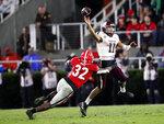 Texas A&M quarterback Kellen Mond (11) throws under pressure from Georgia linebacker Monty Rice (32) in the second half of an NCAA college football game Saturday, Nov. 23, 2019, in Athens, Ga. Georgia won 19-13. (AP Photo/John Bazemore)