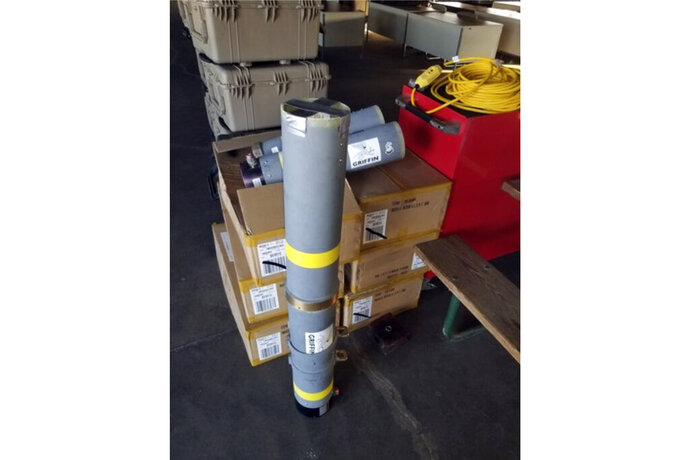 This image released by the Office of the State Fire Marshal's in Maryland, shows a rocket launcher tube that was seized at  baggage area, Thursday, Aug. 1, 2019, at Baltimore/Washington International Thurgood Marshall Airport near Baltimore. The launch tube was brought back on a military flight by an Air Force sergeant as a souvenir from their service abroad. This is the second recovered rocket launcher military souvenir seized at the airport this week. (Office of the State Fire Marshal's via AP)