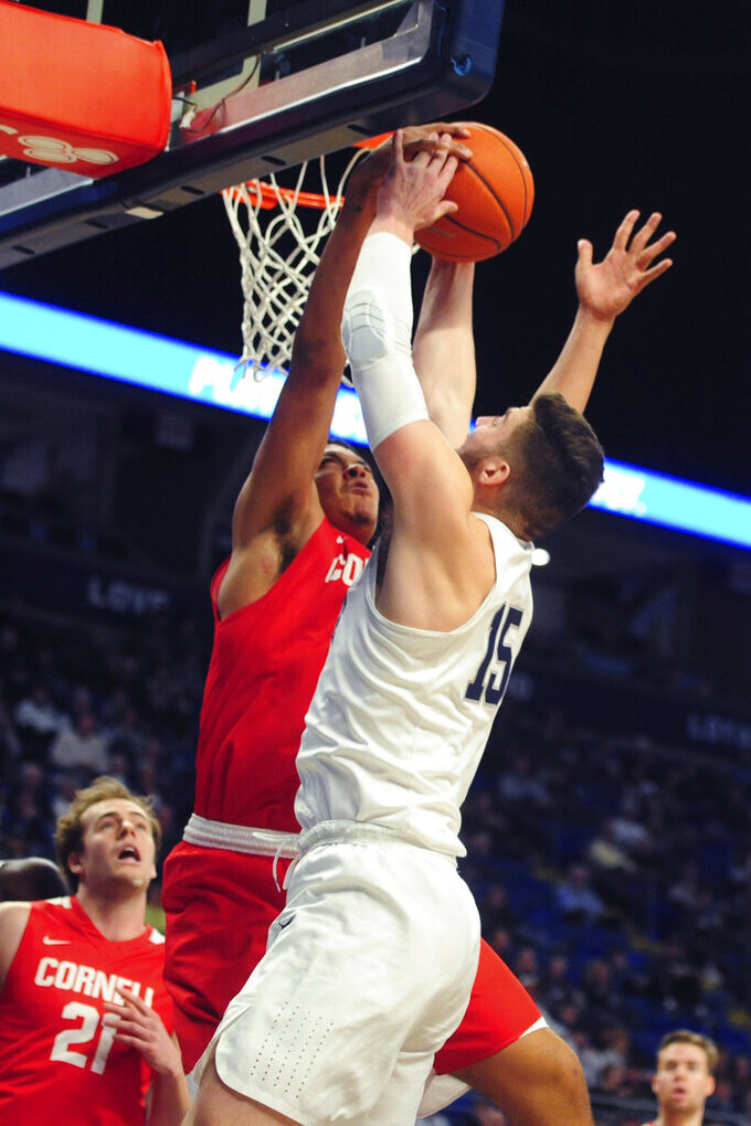 Penn State's Trent Buttrick (15) goes to the hoop on Cornell's Kobe Dickson (12 during first half action of an NCAA college basketball game, Sunday, Dec. 29, 2019, State College, Pa. (AP Photo/Gary M. Baranec)