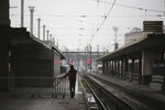 A man stands on a deserted platform at the Gare de Lyon train station, Friday, Dec. 6, 2019 in Paris. Frustrated travelers are meeting transportation chaos around France for a second day, as unions dig in for what they hope is a protracted strike against government plans to redesign the national retirement system. (AP Photo/Rafael Yaghobzadeh)