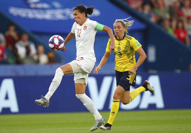 FILE - In this June 24, 2019, file photo, Canada's Christine Sinclair, left, is chased down by Sweden's Linda Sembrant during a Women's World Cup round of 16 soccer match in Paris, France. Sinclair highlights Canada's 20-player roster for the CONCACAF Olympic qualifying tournament starting later this month. Sinclair is one goal away from tying retired U.S. star Abby Wambach's record of 184 goals in international play. (AP Photo/Francisco Seco, File)