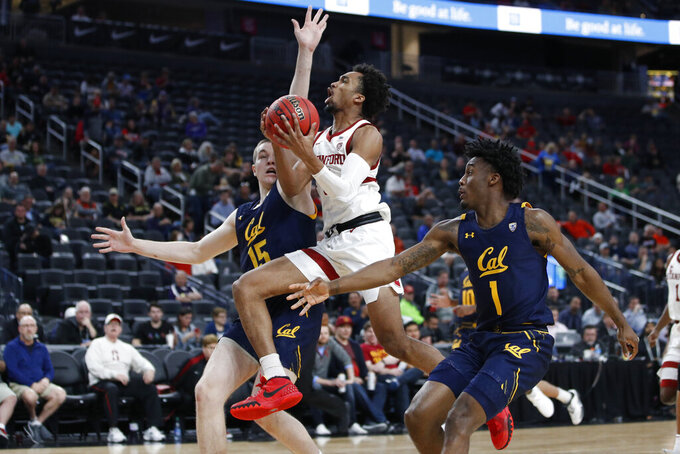 Stanford's Bryce Wills (2) shoots between California's Grant Anticevich, left, and California's Joel Brown during the second half of an NCAA college basketball game in the first round of the Pac-12 men's tournament Wednesday, March 11, 2020, in Las Vegas. (AP Photo/John Locher)