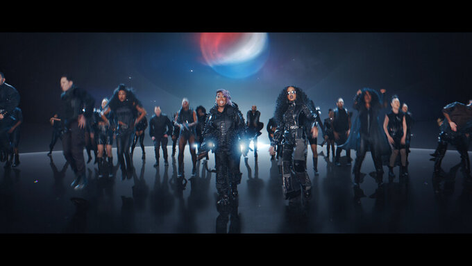 """This undated image provided by PepsiCo shows Missy Elliott, center left, and H.E.R., center, right, in a scene from the company's 2020 Super Bowl NFL football spot. Pepsi tries to reignite the Cola Wars with Missy Elliott and H.E.R. performing an updated version of """"Paint it Black"""" that starts with a red cola can that looks like a Coke changing into a black can of Pepsi Zero Sugar to the lyrics of """"I see a red door and I want it painted black."""" (PepsiCo via AP)"""