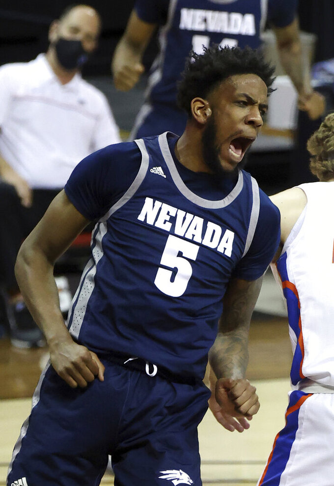 Nevada forward Warren Washington (5) reacts after dunking during the first half of an NCAA college basketball game against Boise State in the quarterfinal round of the Mountain West Conference tournament Thursday, March 11, 2021, in Las Vegas. (AP Photo/Isaac Brekken)