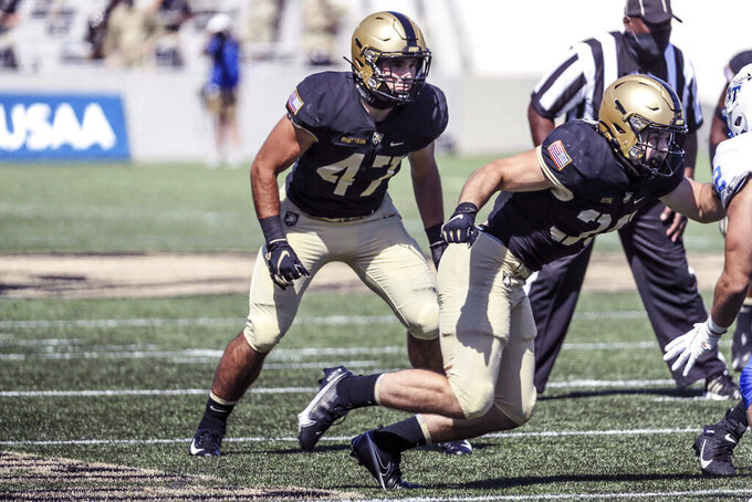 In this Sept. 5, 2020, photo provided by Army Athletics, Army senior linebacker Jon Rhattigan (47) is shown during an NCAA college football game against Middle Tennessee, in West Point, N.Y. This season is his first year starting and he leads the Black Knights in tackles and is one of 18 semifinalists nationally for the Bednarik Award, given to the outstanding defensive player of the year in the nation. (Mark Wellman/Army Athletics via AP)