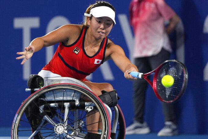 Yui Kamiji of Japan returns to Diede de Groot of the Netherlands during their Wheelchair tennis women's singles final at the Tokyo 2020 Paralympic Games, Friday, Sept. 3, 2021, in Tokyo, Japan. (AP Photo/Shuji Kajiyama)