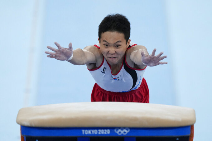 Shin Jeahwan, of South Korea, performs on the vault during the men's artistic gymnastic qualifications at the 2020 Summer Olympics, Saturday, July 24, 2021, in Tokyo. (AP Photo/Natacha Pisarenko)