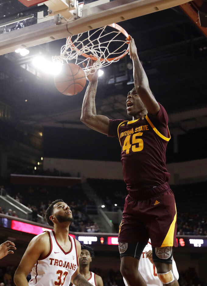 Arizona State forward Zylan Cheatham (45) dunks over Southern California forward J'Raan Brooks (33) during the second half of an NCAA college basketball game Saturday, Jan. 26, 2019, in Los Angeles. (AP Photo/Marcio Jose Sanchez)