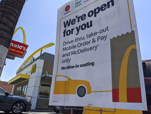 FILE - In this May 20, 2020 file photo, a sign posted outside a McDonald's restaurant reads: