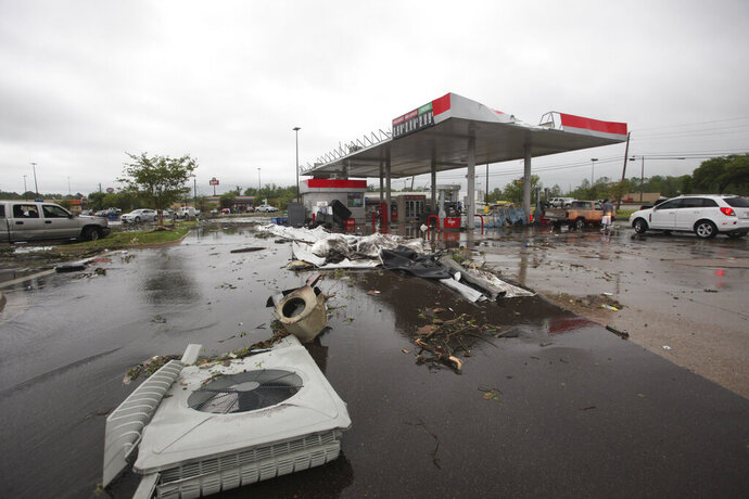 A gas station is damaged following severe weather, Saturday, April 13, 2019 in Vicksburg, Miss. Authorities say a possible tornado has touched down in western Mississippi, causing damage to several businesses and vehicles. John Moore, a forecaster with the National Weather Service in Jackson, says a twister was reported Saturday in the Vicksburg area of Mississippi and was indicated on radar. (Courtland Wells/The Vicksburg Post via AP)