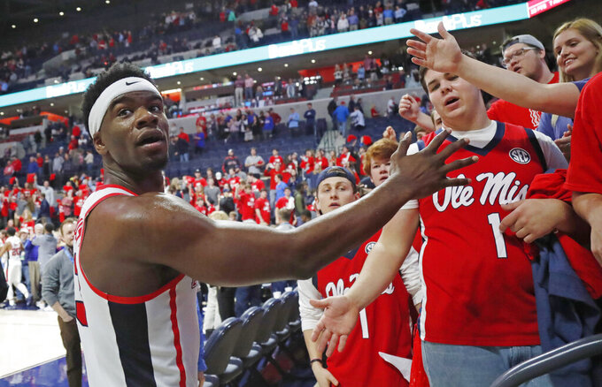 Mississippi guard Terence Davis (3) looks into the stands as he is congratulated by fans after an NCAA college basketball game against Arkansas in Oxford, Miss., Saturday, Jan. 19, 2019. Mississippi won 84-67. (AP Photo/Rogelio V. Solis)