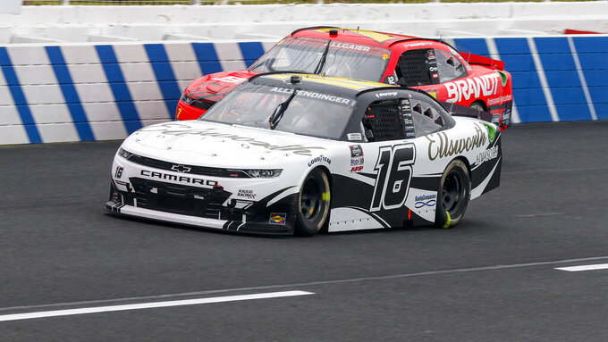 AJ Allmendinger (16) and Justin Allgaier compete in the NASCAR Xfinity Series auto race at Charlotte Motor Speedway in Concord, N.C., Saturday, Oct. 10, 2020. Allmendinger won the race. (AP Photo/Nell Redmond)