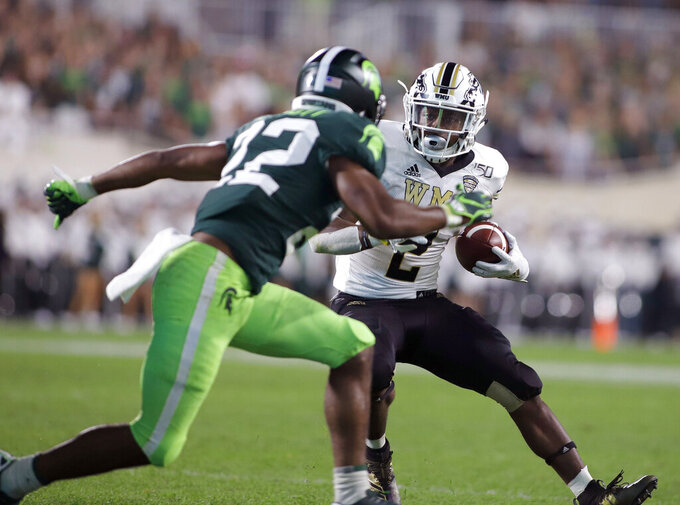 Western Michigan's LeVante Bellamy, right, rushes against Michigan State's Josiah Scott during the second quarter of an NCAA college football game, Saturday, Sept. 7, 2019, in East Lansing, Mich. (AP Photo/Al Goldis)