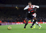 Crystal Palace's Wilfried Zaha, front, duels for the ball with Arsenal's Calum Chambers during the English Premier League soccer match between Arsenal and Crystal Palace at the Emirates stadium in London, Sunday, Oct. 27, 2019. (AP Photo/Leila Coker)