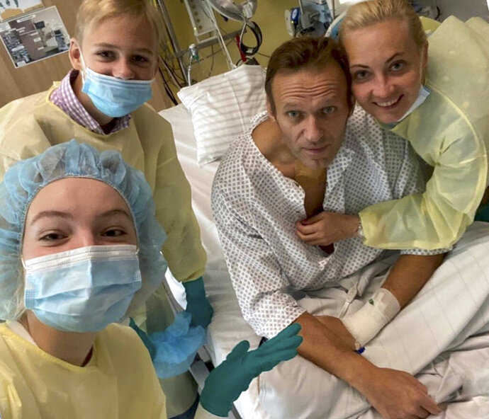This handout photo published by Russian opposition leader Alexei Navalny on his instagram account, shows himself, centre, and his wife Yulia, right, daughter Daria, and son Zakhar, top left, posing for a photo in a hospital in Berlin, Germany.  Russian opposition leader Alexei Navalny has posted the picture of himself in a hospital in Germany and says he's breathing on his own. He posted on Instagram Tuesday Sept. 15, 2020: