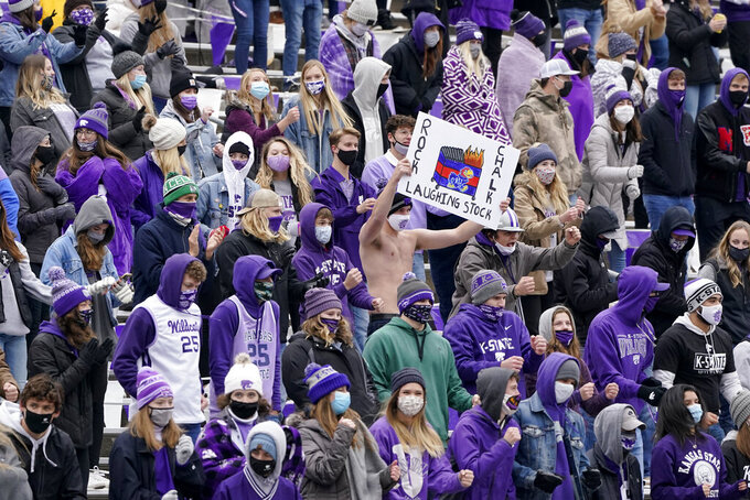 Kansas State fans celebrate during the second half of an NCAA college football game against Kansas Saturday, Oct. 24, 2020, in Manhattan, Kan. (AP Photo/Charlie Riedel)