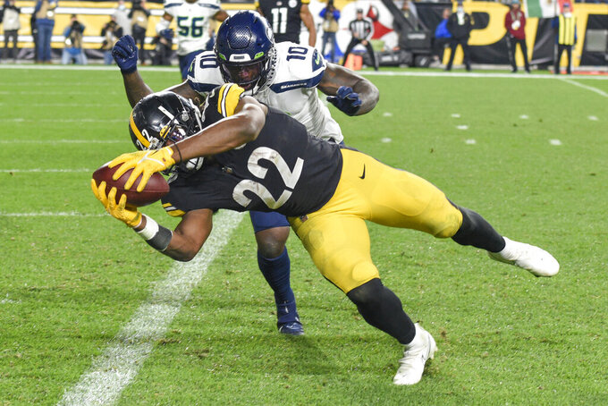 Pittsburgh Steelers running back Najee Harris (22) dashes past Seattle Seahawks defensive end Benson Mayowa (10) on his way to the end zone and a touchdown during the first half an NFL football game, Sunday, Oct. 17, 2021, in Pittsburgh. (AP Photo/Don Wright)