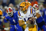 LSU quarterback Max Johnson (14) scrambles during the first half of the team's NCAA college football game against Florida on Saturday, Dec. 12, 2020, in Gainesville, Fla. (AP Photo/John Raoux)