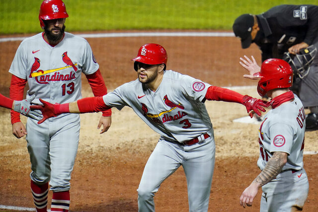St. Louis Cardinals' Dylan Carlson celebrates as he heads to the dugout after hitting a three-run home run off Pittsburgh Pirates relief pitcher Chris Stratton during the sixth inning of the second baseball game of a doubleheader in Pittsburgh, Friday, Sept. 18, 2020. (AP Photo/Gene J. Puskar)
