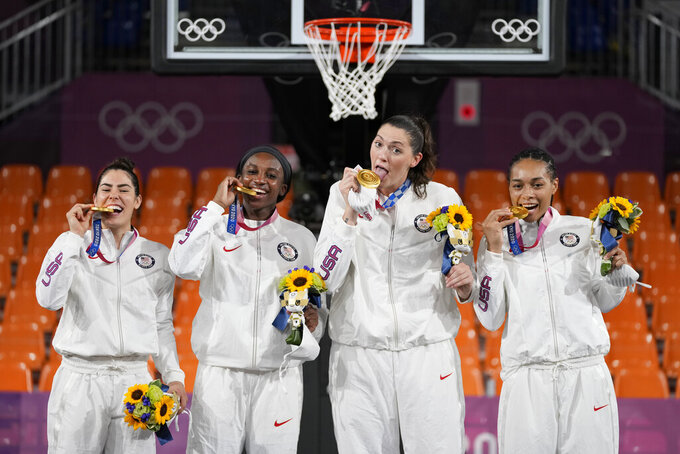 Members of team United States, from left to right, Kelsey Plum, Jacquelyn Young, Stefanie Dolson and Allisha Gray pose with their gold medals during the awards ceremony for women's 3-on-3 basketball at the 2020 Summer Olympics, Wednesday, July 28, 2021, in Tokyo, Japan. (AP Photo/Jeff Roberson)