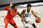 Central Florida guard Darin Green Jr. (22) drives around Auburn forward Javon Franklin (4) during the first half of an NCAA college basketball game, Monday, Nov. 30, 2020, in Orlando, Fla. (AP Photo/John Raoux)
