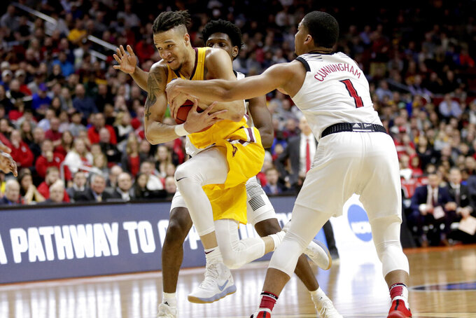Minnesota's Amir Coffey (5) drives to the basket past Louisville's Christen Cunningham (1) during the second half of a first round men's college basketball game in the NCAA Tournament, in Des Moines, Iowa, Thursday, March 21, 2019. (AP Photo/Nati Harnik)