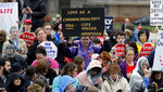 FILE - In this Feb. 13, 2020, file photo, demonstrators hold up a signs during the Virginia March for Life rally outside the Virginia State Capitol in Richmond, Va. Anti-abortion leaders across America were elated a year ago when Donald Trump became the first sitting U.S. president to appear in person at their highest-profile annual event, the March for Life held every January. The mood is more sober now — a mix of disappointment over Trump's defeat and hope that his legacy of judicial appointments will lead to future court victories limiting abortion rights. (Bob Brown/Richmond Times-Dispatch via AP, File)