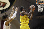 Maryland's Jalen Smith, right, shoots against Indiana's Trayce Jackson-Davis (4) during the second half of an NCAA college basketball game, Sunday, Jan. 26, 2020, in Bloomington, Ind. (AP Photo/Darron Cummings)