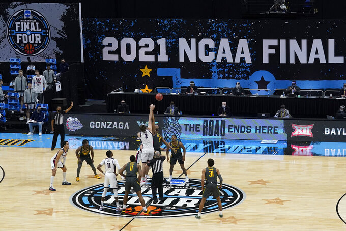 Players jump for the opening tipoff at the start of the championship game between Gonzaga and Baylor in the men's Final Four NCAA college basketball tournament, Monday, April 5, 2021, at Lucas Oil Stadium in Indianapolis. (AP Photo/Darron Cummings)