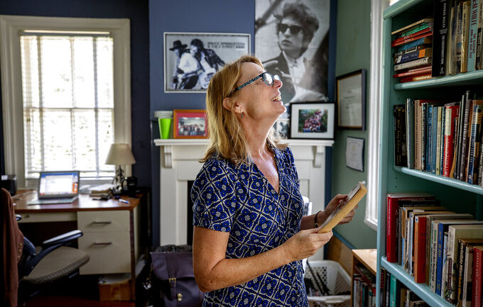Susan Farrell, an English professor at the College of Charleston and founder of the Kurt Vonnegut Society flips through her Slaughter House Five book, full of notes, that she uses for teaching, Wednesday, Aug. 25, 2021 in Charleston, S.C. (Grace Beahm Alford/The Post and Courier via AP)