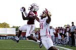 Massachusetts wide receiver Eric Collins (80) makes a touchdown catch against Boston College defensive back Josh DeBerry (21) during the second half of an NCAA college football game, Saturday, Sept. 11, 2021, in Amherst, Mass. (AP Photo/Michael Dwyer)